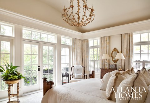 The cream-colored palette continues throughout the house, creating a series of soft, inviting spaces, from a light-filled bedroom and seating area to a serene bathroom.