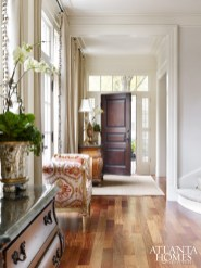 Architect Jim Strickland, founder of Peachtree City-based Historical Concepts, worked with Marcia and Mike Taylor to fashion a home ideal for entertaining. Classical moldings, a raised panel door, and large windows make a strong architectural statement in the foyer.