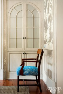 The vibrant blue Sabina Fay Braxton upholstery adds old-world patina to a dining chair.