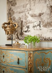 A blue and gold Italian commode (purchased from an antiques dealer's personal collection) fit the bill in the living room.