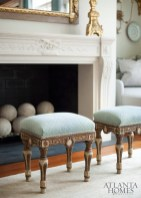 Antique stools in the formal living room are one of several clusters of seating areas designed to be conducive to cocktail-party conversations.