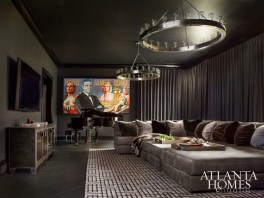 The media room evokes masculinity with the industrial chandeliers from Circa Lighting and James Bond pop art by Mark Boomershine.