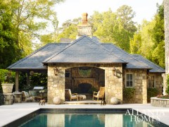 """""""The pool and outdoor living spaces are part of the evolution of this home and were added later,"""" says Weaks. """"The Hillses and their large family love to be outdoors when possible, so these areas are used all the time."""" Rick Hatch of Harrison Design designed the pool and pool house."""