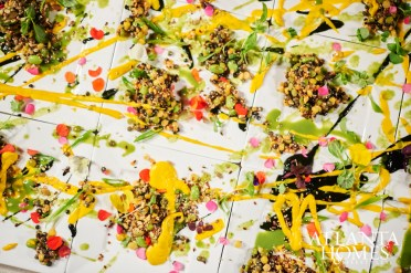 Chef Tyler Williams's first course was an ode to Pollock with a smattering of seeds, grains, lentils, ink and edible flowers.