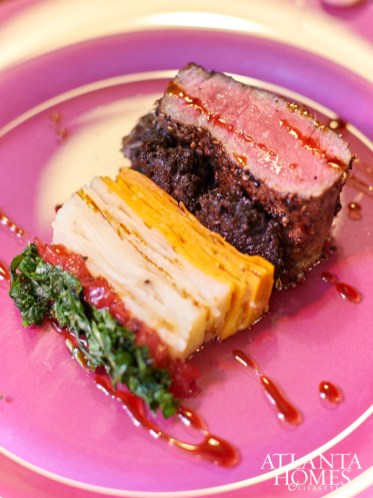 A Rothko-inspired entree features a New York strip with cuts of potato pave, wild mushroom aspic, carmelized shallot and thyme.