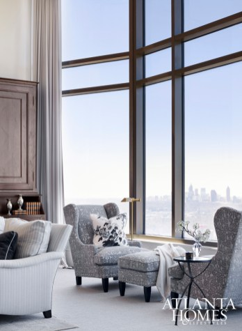 The blue and gray skies of Atlanta provided a starting point for the interior's color palette. The supersized windows are softened with fabric panels in semisheer wool by Larsen.