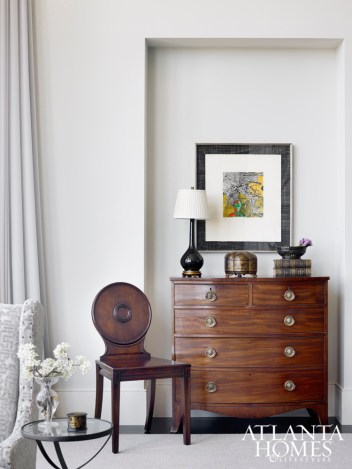 In a formal living room niche, wood finishes help balance masculine and feminine design elements.