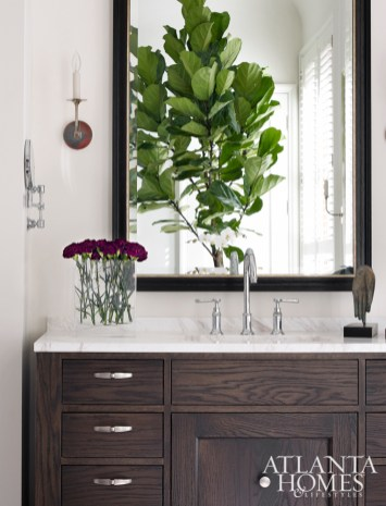Dark Block & Chisel cabinetry is a striking contrast to the master bathroom's pale color palette.