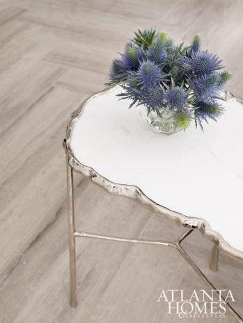 Herringbone floors and elegant furnishings give this master bathroom designed by Joel Kelly a streamlined feel.