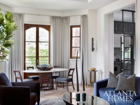 In the breakfast nook, a sculptural McGuire table and chairs contribute to the home's clean-lined feel.