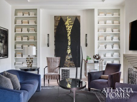 A large Donald Sultan painting commands attention in the family room, where Donghia furniture and a tall chair by Barbara Barry create a comfortable but elegant living space.
