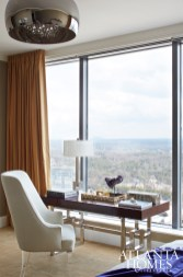 The master bedroom features a writing desk with enviable sky-high views.