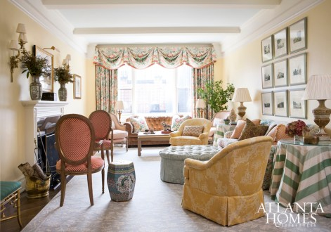 Framed prints from Fred Reed balance porcelains from Jane Marsden Antiques on the mantel. A pair of chairs from Lee Jofa upholstered in a sunny yellow chinoiserie by Scalamandré adds a bright pop to the room. Carpet by Stark and lighting by Parc Monceau.