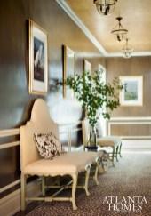 Chocolate strié paint complements gilt tea-leaf paper on the ceiling.