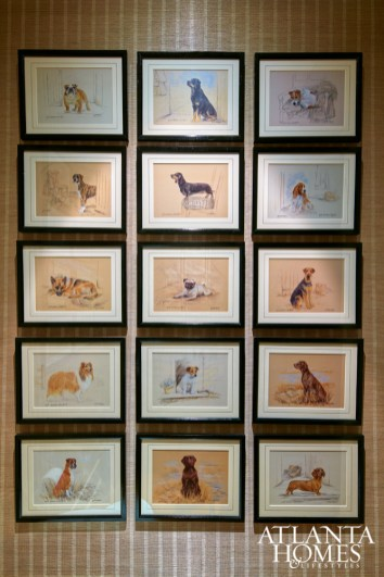 In the powder room, a collection of vintage Gill Evans lithographs, found at Peachtree Battle Antiques, is a testament to the homeowner's love of dogs.