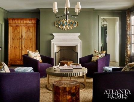 Nixing the traditional sofa-and-chairs setup in favor of an arrangement that wouldn't impede flow in this high-traffic area, Woodbery introduced velvet swivel chairs flanked by a mix of low-slung stools.