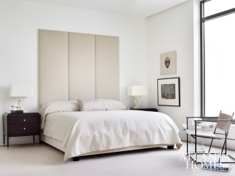 In the master bedroom, softness prevails thanks to a statuesque headboard custom-designed by Brown, and the Stark rug. Baker's metal and leather chair adds visual interest.