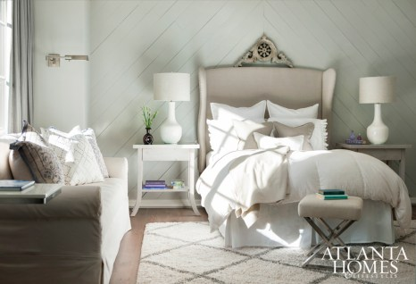 Thanks to large, leaded windows, natural light pours into this neutral-hued bedroom.
