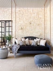 Pillows by Lacefield cover the custom porch swing–meets–day bed that's perfect for afternoon catnaps.