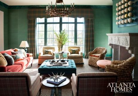 Floor-to-ceiling color, touches of animal print and deep jewel tones transform this family room into an intimate space.
