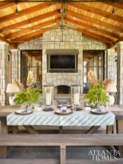 The back porch is equipped with a grill and pizza oven, perfect for a festive cookout. Its Restoration Hardware farm table and benches can accommodate casual suppers as well as more formal outdoor dinner parties.