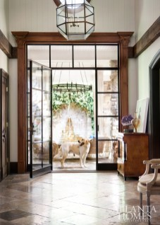 The outside and inside seamlessly intertwine thanks to large-scale, iron-trimmed doorways that lead to the front courtyard, where family dog Rambo is occasionally known to hold court.