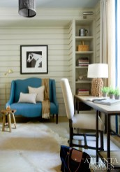 The study, featuring a teal settee from South of Market, provides the perfect spot for a quiet moment. The desk is Ballard Designs, the chairs are Noir, the lamp is from B.D. Jeffries and the artwork is from Stanton Home Furnishings.