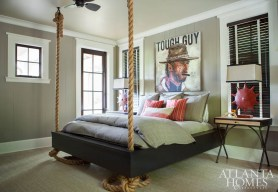 The designer collaborated with builder Chris Clay to create a floating bed for the son's bedroom. Its masculine vibe is matched by artwork by Mark Boomershine and repurposed lamps from Antiques & Beyond.