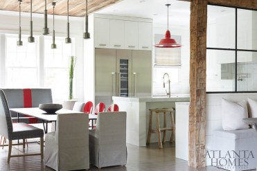 Rustic flourishes temper the clean lines of this mountain retreat designed by Kay Douglass. She procured many of the furnishings, including this dining table and mix of seating, from South of Market, her interiors showroom in Atlanta brimming with unique finds.