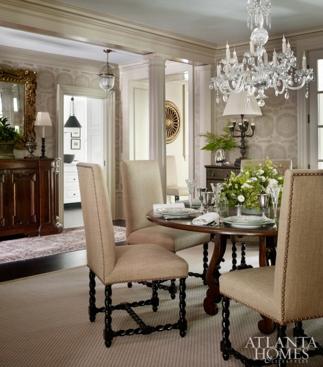 Lanham painted the dining room ceiling blue and upholstered walls in a Jasper fabric.