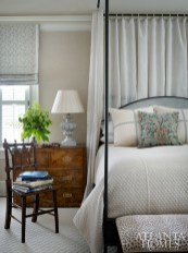 """The wife gravitates toward a look that is tailored but feminine, with soft colors and not too much pattern,"" says Lanham; the effect in the master bedroom is calm and collected."