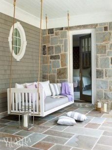 A suspended swing invites naps on the covered porch.