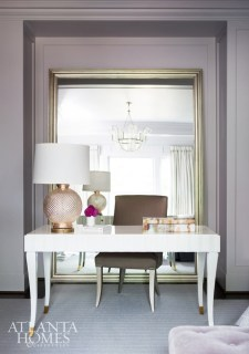 Subtle curves contribute to the room's feminine appeal. An oversized mirror sets off the clean-lined writing niche.