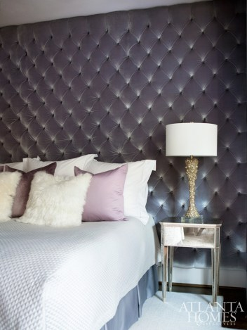 Feeling that an upholstered headboard would appear lost in the master bedroom sleeping niche, Morris cleverly upholstered the whole space in a pale purple velvet by Theo with tufted detailing. Mirrored side tables by Coup D'Etat and custom white lacquered pieces show off midcentury Hollywood style.