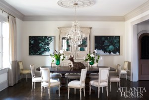In the dining room, a pair of lime tree paintings by Joan Bonetti adds subtle drama to the otherwise tranquil room. The walls are China White with Revere Pewter trim, both by Benjamin Moore. An antique armoire from Interiors Market and a rock crystal chandelier from Pasadena Antique Center unify the space's West Coast style and Southern sensibility impeccably curated by Meier.