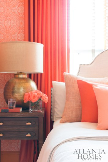 Meg splurged on custom upholstery in the form of a breakfast nook banquette and statement pillows and window treatments in the master bedroom.