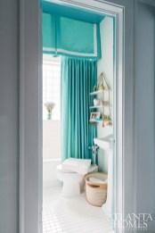 Aqua tones brighten up the home's single bathroom.