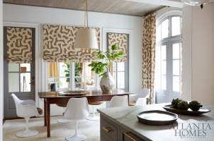 Not one to shy away from pattern, Woodbery selected a playful Jed Johnson fabric for the breakfast room. The light fixture is from Paul + and the tulip chairs are vintage Knoll.