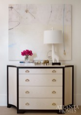 The chest of drawers is by Lillian August.