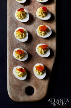 Deviled Summerland farm eggs with housecured hunter's loop and spicy pickles.