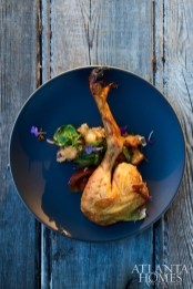 A beautifully plated, pot-roasted hen with garden panzanella.