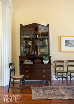 """A Federal secretary and 19th-century Baltimore """"Fancy"""" chairs flank one side of the wide central hallway."""