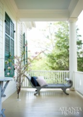 On the spacious porch, a recamier by Mike Reid Weeks serves as a comfortable respite, with pillows from Janus et Cie.