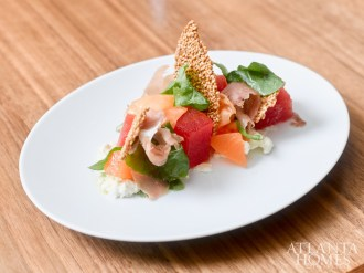 Compressed melon salad with country ham, ricotta, benne tuille and arugula.