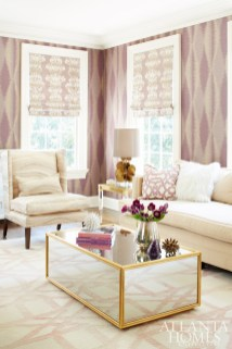 In lieu of heavy draperies in the living room, the homeowners opted for streamlined shades by Urban Decors in Jim Thompson's Carmen fabric in lilac.