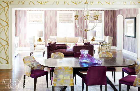 Designer Kristin Kong used distinctive wallcoverings (Umi by Zoffany in the living room and Sumi by Harlequin in the dining room) to highlight the two adjoining spaces.