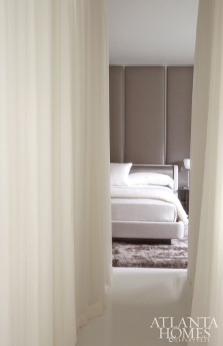 100 yards of custom sheer wool drapery by C&C Drapery envelop the bedroom, creating a peaceful escape.