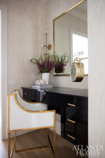A custom vanity offers the wife a chic spot to start her day, while a cozy seating area just outside the bedroom offers a place to unwind at the day's end.