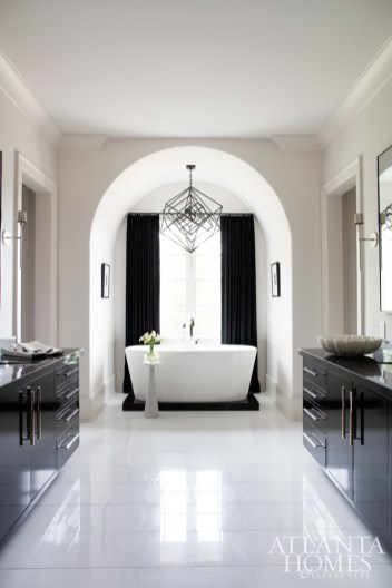 Broaddus and contractor Mike Hammersmith delivered a spa-like bath complete with custom vanities, a soaking tub and marble flooring. Chandelier, Kelly Wearstler through Circa Lighting. Hardware, Matthew Quinn Collection. Vanities, Stile Inc. Tub, Wet Style through PDI.