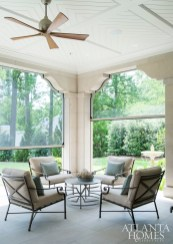 Off the main floor living room, seamless electronically-powered screen panels were installed so the homeowners could enjoy the great outdoors sans the mosquitoes.